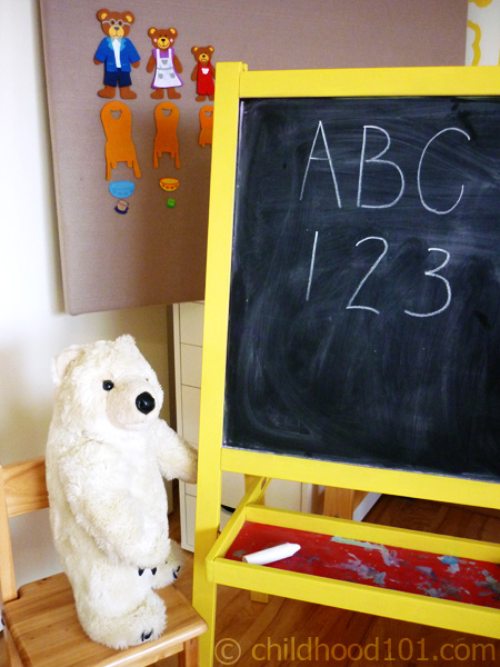 Teddy bear as teacher at the yellow chalkboard easel, via Childhood101