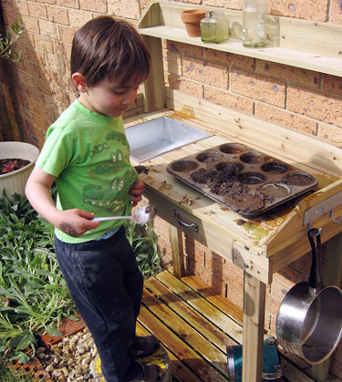 making a mud play kitchen