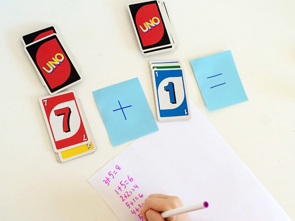 Math games for kids: Uno flip for number sentences