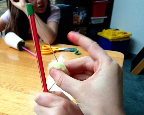 Pom pom launcher bow and arrow style