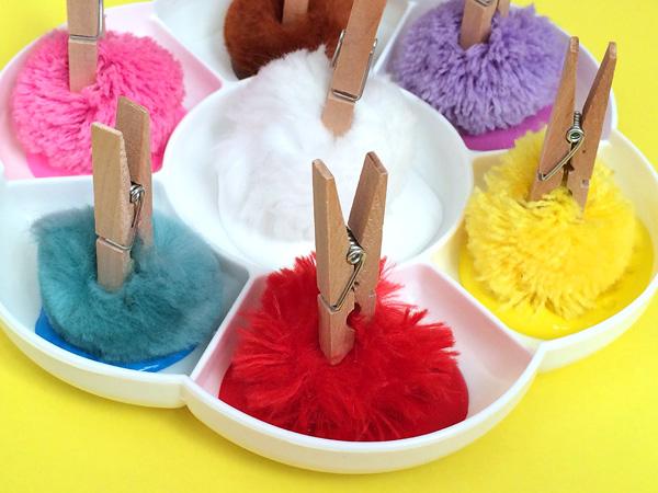 Toddler play ideas: Pom pom peg painting