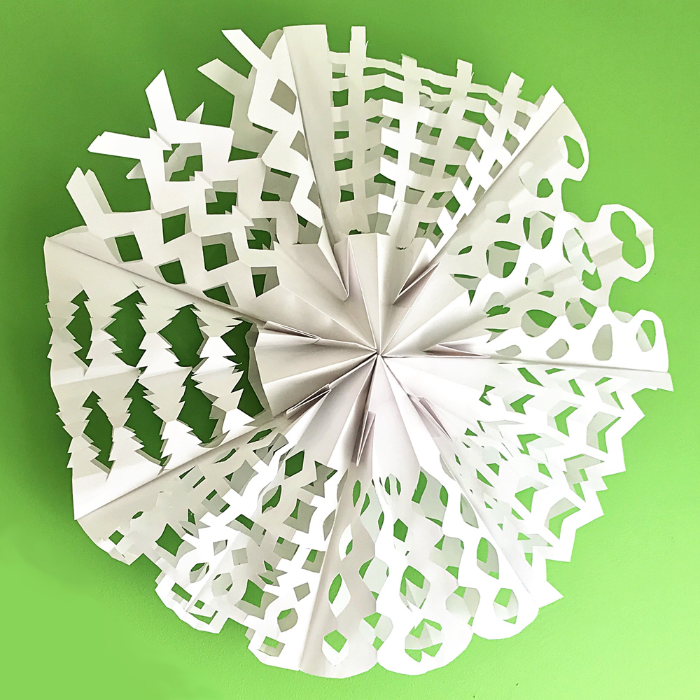 Giant Paper Bag Snowflakes Tutorial. Such a fun Christmas craft!